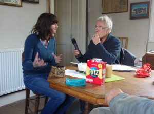 Peter interviewing Clare and enjoying some cheese at the same time!